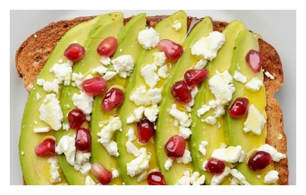 Avocado pomegranate toast with cheese