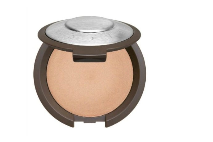 Becca Shimmering Skin Perfecctor Champagne Pop poured cream