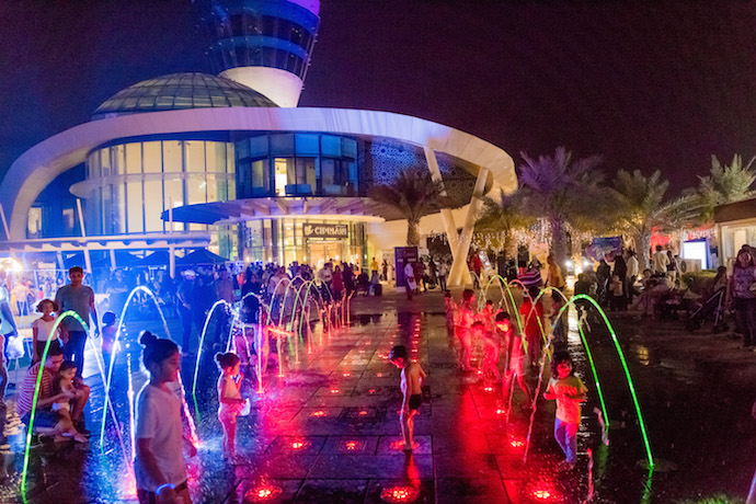 Yas Promenade at Yas Marina by night