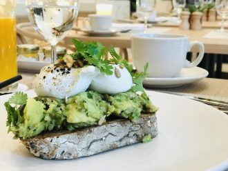Avocado Toast topped with a poached egg