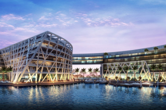 """If you need to escape Dubai for a short stay in the capital or if you live in Abu Dhabi and simply need a break, head over to the sleekest spot in the capital, The Abu Dhabi EDITION. A relative newcomer to the scene (it opened in November 2018), the boutique hotel is worth a visit not only for the fantastic hotel design, and its great location, but also for its top notch dining offerings. LOCATION Situated on the Al Bateen peninsula, this quiet enclave is only a five-minute drive to Emirates Palace and Qsar Al Watan (for more details click here), making it a convenient base from which to visit some of Abu Dhabi landmarks. Although there is no access to a beach, the Abu Dhabi Corniche is only a short drive from the hotel, while Saadiyat Island and the cultural district are just 20 minutes away. DESIGN The Abu Dhabi EDITION is not stuffy nor fussy like some traditional five-star hotels, but neat and modern. The emphasis is on minimalist luxury but it still manages to pull off a cosy, welcoming feel. Rooms are slick with wood panelling and northern European furniture. Built around a marina, The Abu Dhabi EDITION sports fantastic water and city views. The interior of the hotel is quite striking: a five-floor lobby with a curved atrium with a sinuously shaped balustrade that reminds the movement of water. [caption id=""""attachment_49993"""" align=""""aligncenter"""" width=""""690""""] Curved lobby at The Abu Dhabi Edition[/caption] On the leisure-side, there are two outdoors pools to chill out by within the hotel, one of which is on the roof top overlooking the marina (photo below). [caption id=""""attachment_49990"""" align=""""aligncenter"""" width=""""690""""] Roof top swimming pool at The Abu Dhabi Edition[/caption]  [caption id=""""attachment_49992"""" align=""""aligncenter"""" width=""""690""""] Swimming pool with poolside bar[/caption]  DINING The hotel has three signature restaurants created by chef Tom Aikens, famous for being the youngest chef to ever have been awarded two Michelin stars. Each is unique and worth"""